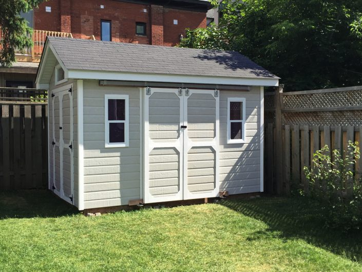 New shed designed along with client using Canexel siding to match existing house.