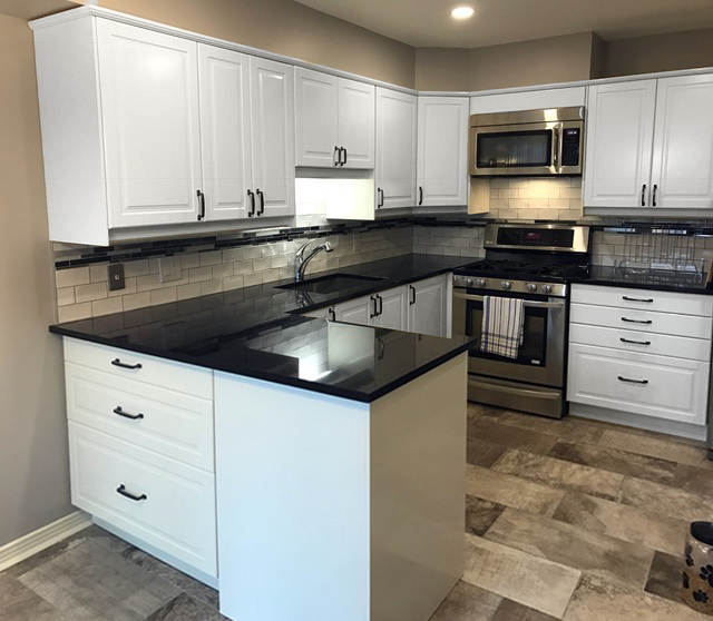 Complete new kitchen renovation with IKEA® cabinets, porcelain tile floor, granite counter tops, tile back splash and new lighting.